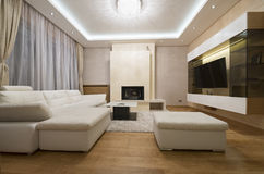 Interior of a specious living room with fireplace Royalty Free Stock Photos