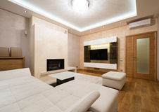 Interior of a specious living room with fireplace Royalty Free Stock Images