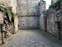 Interior of Spofforth Castle Ruins in Yorkshire England. Showing walls, stonework, masonry, foundations archway stock photo
