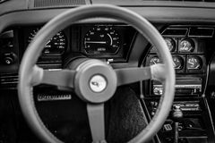 Interior of the sports car Chevrolet Corvette C3, 1982. PAAREN IM GLIEN, GERMANY - JUNE 03, 2017: Interior of the sports car Chevrolet Corvette C3, 1982. Black Royalty Free Stock Photography
