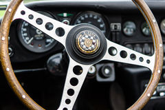 Interior of the sports car Jaguar E-Type, closeup. PAAREN IM GLIEN, GERMANY - JUNE 03, 2017: Interior of the sports car Jaguar E-Type, closeup. Exhibition `Die Stock Photo