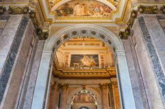 Interior of the St Isaac Cathedral in St Petersburg, Russia. Decorated ceiling and pink marble walls Royalty Free Stock Images