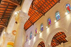 Interior of St. Joseph`s Church,a Franciscan Roman Catholic church in the Old City. Built in 1914 over the remains of much older churches, Nazareth, Israel stock photos
