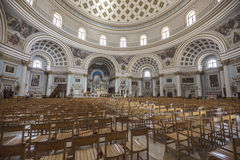 Interior of St. Mary`s church at Mosta on Malta. Interior of St. Mary`s church at Mosta on Malta below huge dome, showing beautifully decorated walls and arches Royalty Free Stock Photos