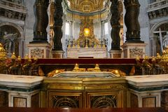 The interior of St.Peters basilica. Altar and Saint Peter`s tomb Stock Photo