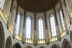 Interior with stained glass windows windows of the New Church in Amsterdam, Netherlands Stock Photos