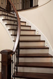 Interior stairs. Interior wooden stairs with metal railing Stock Photo