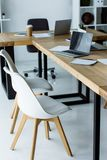 Interior of start up office with laptops and coffee in paper cups. On tables stock photos