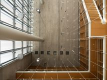 Interior of the Stavros Niarchos Cultural Center on a sunny day with shadows royalty free stock image