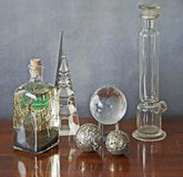Glass paraphernalia on a wooden table Royalty Free Stock Image