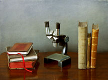Microscope and books Royalty Free Stock Images
