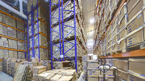 Interior storage warehouse, stacked shelving shelves with cardbo Stock Photo