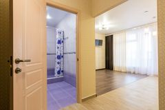 Interior of studio apartment, open door to bathroom and view of the room Stock Images