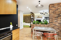 Interior studio apartments, with a kitchen and wooden floors Royalty Free Stock Photography