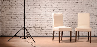 Interior of studio with chairs and brick wall Stock Image