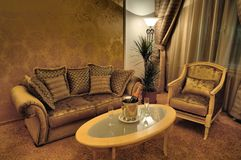 Interior with stylish furniture and sparkling wine Royalty Free Stock Photo