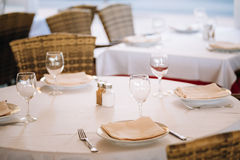 The interior of summer cafe - sheltered tables stock photography