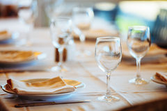 The interior of summer cafe - sheltered tables with white tablecloths royalty free stock photo