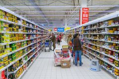 The interior of a supermarket with consumers. Moscow, Russia, may 2018: The interior of a supermarket with consumers editorial stock photos