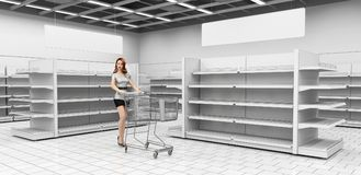 Interior of a supermarket with storefronts and shelves. Girl with a cart for goods. Royalty Free Stock Photos