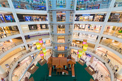 Interior of Suria KLCC shopping mall in Kuala Lumpur, Malaysia. KUALA LUMPUR - JUNE 15, 2016: Unidentified people walk on 6 floors of the Suria KLCC shopping Stock Photography