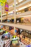Interior of Suria KLCC shopping mall, Kuala Lumpur, Malaysia. KUALA LUMPUR - JUNE 15, 2016: Unidentified people walk inside Suria KLCC shopping mall. The mall is Stock Photos