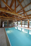Interior of swimming pool inside of house Royalty Free Stock Photography
