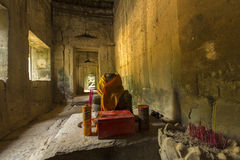 Interior of Ta Prohm temple with incense sticks, Cambodia Stock Photography