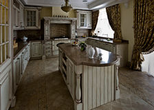Interior of a table room in in classical style. With a kind on kitchen and a bar rack Stock Photos