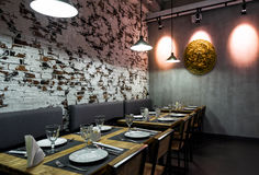 Interior of a Thai restaurant. Moscow - August 5, 2017: Interior of a Thai restaurant with brick wall royalty free stock image