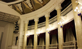 The interior of the theater Baroque. The interior of the building of the theatre view balconies, columns, carved ceiling, lamp lighting fixtures, equipment for Royalty Free Stock Photo