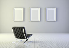 Interior with three frames and armchair Stock Image