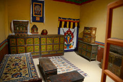 Interior of Tibetan house. Seen from the window. There is a portrait of buddha hang on the living room wall. The same convention for every Tibetan family Stock Images