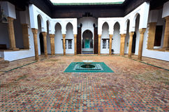 Interior tiled courtyard and fountain of madrasa Stock Photo