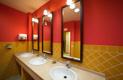 Interior of toilet with few sinks i Stock Image