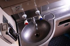 The interior of the toilet on the train. Details and close-up. royalty free stock image