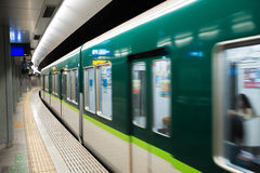 Interior of a Tokyo subway station and platform with subway comm Royalty Free Stock Photography