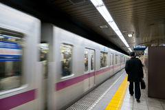 Interior of a Tokyo subway station and platform with subway comm Royalty Free Stock Images