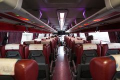 Interior of a tourist bus from the back seat. royalty free stock photography