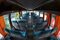 Interior of the tourist bus for excursions and long trips. A lot of free seats and places for small luggage.  royalty free stock image