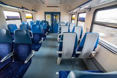 interior of the train car with empty seats Stock Photos