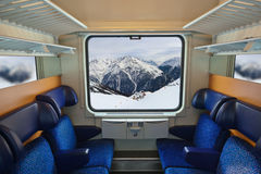 Interior of train and mountains in window Royalty Free Stock Images