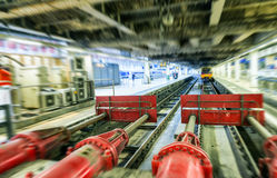 Interior of Train Station with track and trains Royalty Free Stock Photos