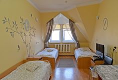 Interior of the triple hotel room with a portrait of the Russian poet Sergey Yesenin on a wall.  Royalty Free Stock Images