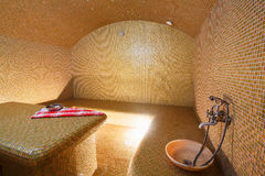 Interior of Turkish sauna, hammam at spa center. Interior of Turkish sauna, classic Turkish hammam at spa center. Spa, relaxation and resort health care center Royalty Free Stock Photos