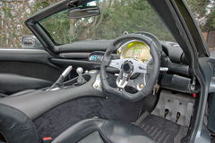 Interior of TVR sports car. Black leather dash and interior of TVR English sports car convertible Stock Photography