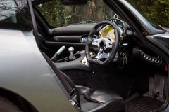 Interior of TVR Tuscan English sport car. The interior of TVR Tuscan, English sport car, driver seat, steering wheel and dashboard Stock Photo