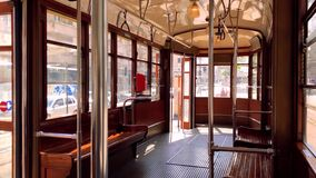 Interior of a typical historic Milan tram with wooden interiors. 4K Quality. Interior of a typical historic Milan tram with wooden interiors during a sunny day stock footage