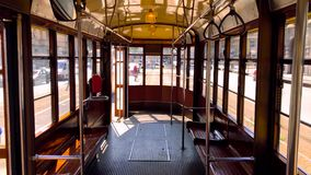 Interior of a typical historic Milan tram with wooden interiors 2. 4K Quality. Interior of a typical historic Milan tram with wooden interiors during a sunny day stock footage