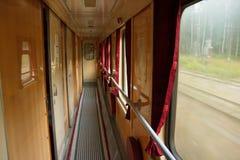 Interior of Ukrainian old railway carriage corridor on the move Royalty Free Stock Photo
